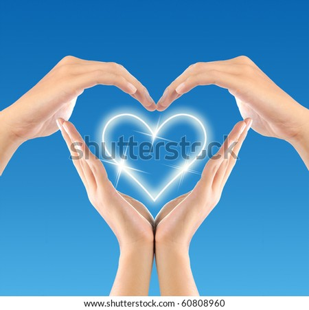 shape of love sign made by hands - stock photo