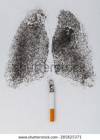 Shape of lungs with charcoal powder and cigarette on white background - stock photo