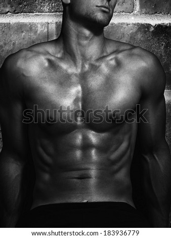shape of sporty male body on dark