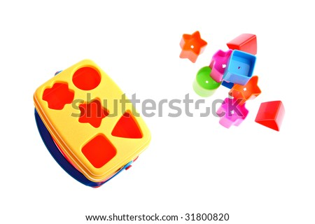Shape sorter toy with various coloured blocks (red, blue, green, orange and magenta) isolated on white. Copy space and room for text available - stock photo