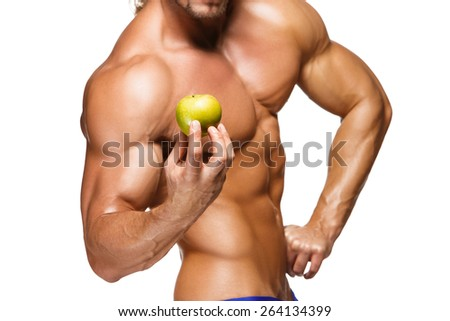 Shaped and healthy body man holding a fresh apple fruits, isolated on white background - stock photo