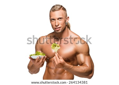 Shaped and healthy body man holding a fresh lettuce, isolated on white background - stock photo
