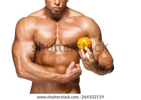Shaped and healthy body man holding a fresh orange fruits, isolated on white background - stock photo