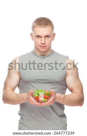 Shaped and healthy body man holding a fresh salad bowl,shaped abdominal, isolated on white background, colored retouched. - stock photo