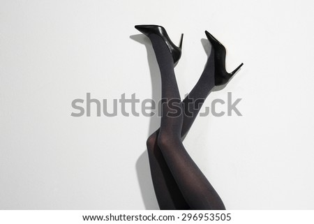 Shapely female legs. Beautiful, leggy woman in thin tights and fashionable styling - stock photo