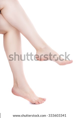 shapely female legs. Isolation on a white background. foot care