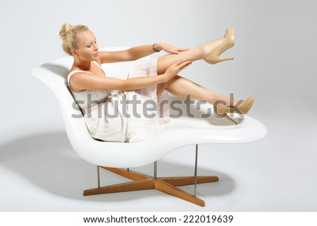 Shapely, smooth legs. Young, beautiful, attractive woman massaging beautiful legs - stock photo