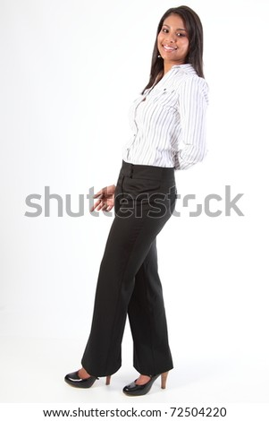 Shapely young black business woman standing side on