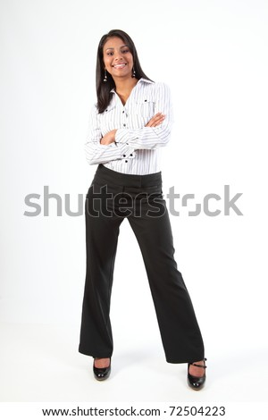 Shapely young black business woman standing smiling with arms folded