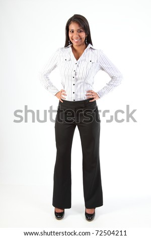 Shapely young black business woman standing with hands on hips