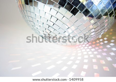 shapes of light cast by a discoball - stock photo