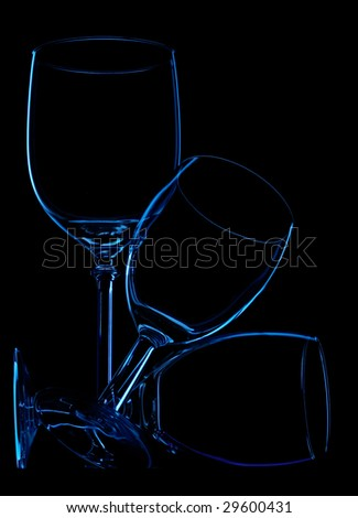 shapes of 3 wineglasses over black - stock photo