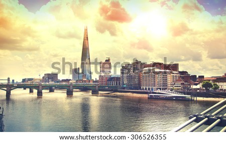 Shard of glass and river Thames - stock photo