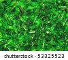 Shards of glass bottles green, scattered on the white surface. - stock photo