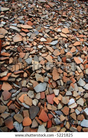Shards of Native American pottery scattered on the ground. - stock photo