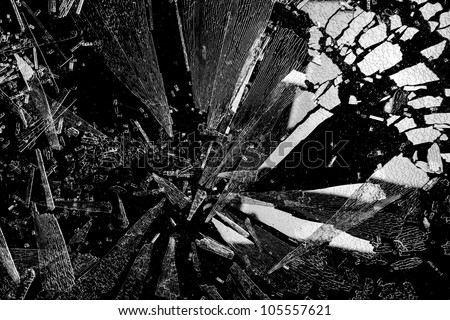 Shards of shattered glass with reflecting light. - stock photo