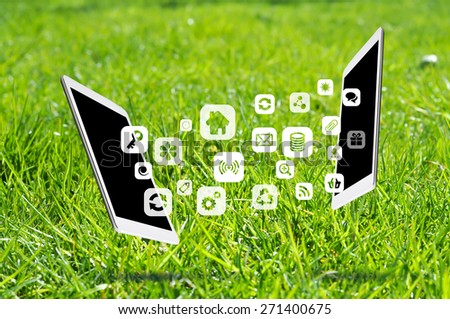 Share apps between digital devices or tablets - stock photo