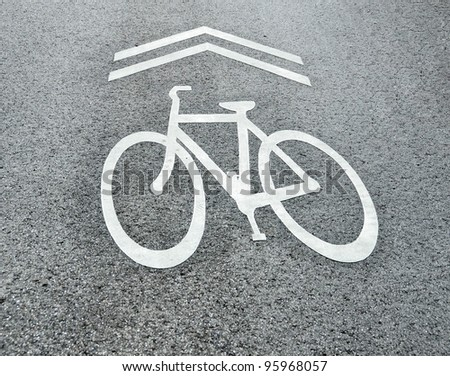 Share the road bicycle sign painted on a street in Athens, Georgia, USA. - stock photo