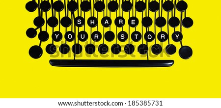 Share your story spelled on a vintage keyboard on yellow - stock photo