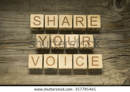 Share Your Voice text on a wooden cubes