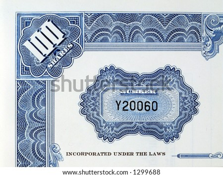 Shares certificate with serial number - stock photo
