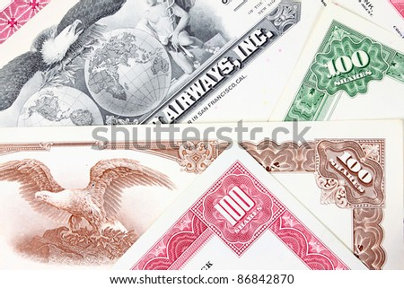 Shares - stock market share certificates from 1950s. Investment and finance business in America. Obsolete collectible documents. - stock photo