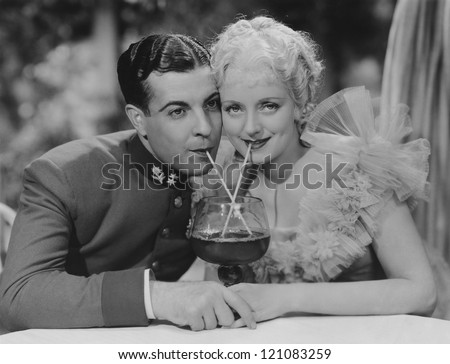 Sharing a drink - stock photo