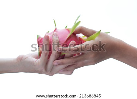 Sharing fruit. Women giving bread to a small child. Charity concept.  - stock photo