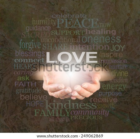 Sharing Love with You -  Female hands cupped with the word 'LOVE'  floating above surrounded by a word cloud of love related words on a rustic mosaic shell effect background - stock photo