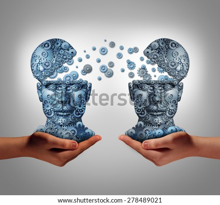 Sharing technology business concept as hands holding two human heads made of gears and cog wheels exchanging information as a symbol and financial metaphor for buying and selling or share data. - stock photo