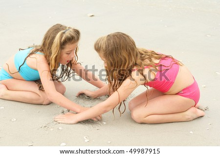sharing the sand - stock photo