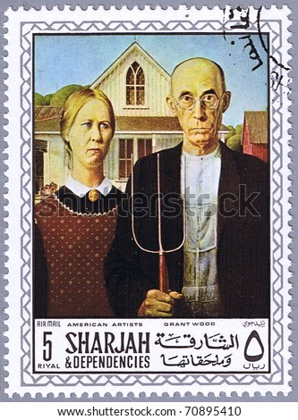 SHARJAH - CIRCA 1968: A stamp printed in Sharjah shows painting of Grant Wood - American Gothic, series, circa 1968 - stock photo