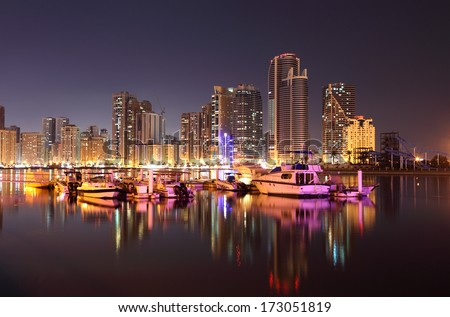 Sharjah Creek at night. United Arab Emirates - stock photo