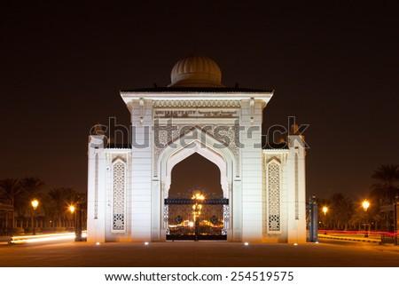 SHARJAH, UAE - DEC 17: University City of Sharjah Entrance Gate at night. December 17, 2014 in Sharjah, UAE - stock photo