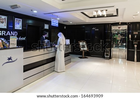 SHARJAH, UAE - NOVEMBER 4: Reception Royal Grand Suite Hotel. Hotel has 136 guestrooms. Guests can use the in-room complimentary wireless high-speed Internet access on November 4, 2013. - stock photo