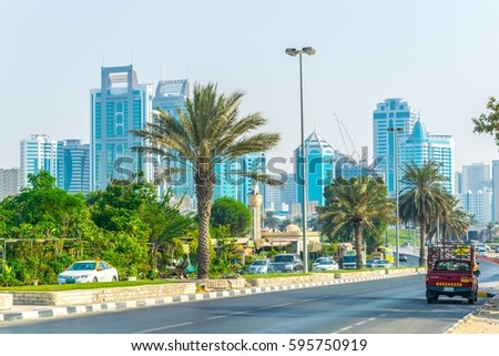 SHARJAH, UAE, OCTOBER 24, 2016: Cars are approaching center of the Sharjah emirate thourgh a busy highway.