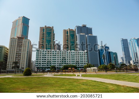 SHARJAH, UAE - OCTOBER 29, 2013: Modern buildings in Sharjah. It is the most industrialized emirate in UAE.