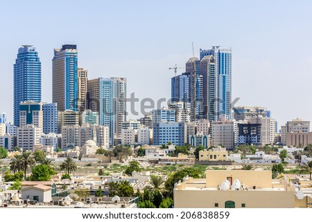 SHARJAH, UAE - SEPTEMBER 27, 2012: Sharjah - third largest and most populous city in United Arab Emirates. Sharjah is located along northern coast of Persian Gulf on Arabian Peninsula.