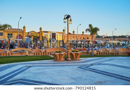 SHARM EL SHEIKH, EGYPT- DECEMBER 15, 2017: Sahaba mosque square is occupied with park, decorated with fountains and cacti in pots, Old Bazaar stores are seen on background, on December 15 in Sharm.