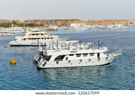 SHARM EL SHEIKH, EGYPT -  DECEMBER 4: The sail yachts with tourists are in harbor of Sharm el Sheikh. It is popular tourists destination on December 4, 2013 in Sharm el Sheikh, Egypt
