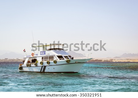SHARM EL SHEIKH, EGYPT - FEBRUARY 25, 2014: Tourist boat trip around the Sinai on the white yacht, a luxury vacation for tourists in the Red sea, relax on the waves, Sharm El Sheikh, Egypt