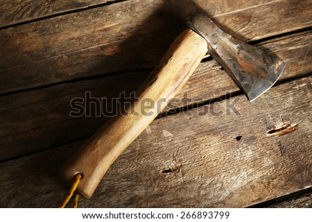 Sharp axe on wooden background - stock photo