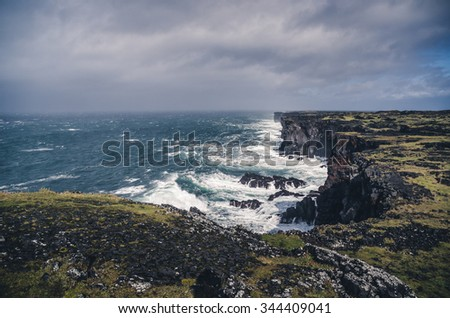 sharp cliffs in stormy sea weather - stock photo