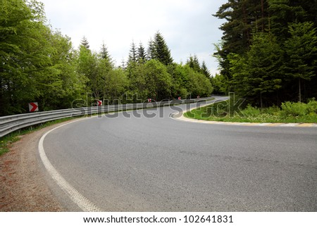 Sharp curve of road - stock photo