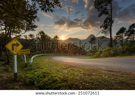 Sharp curve on mountain with sunset time at Doi Angkhang,Chiengmai,Thailand - stock photo