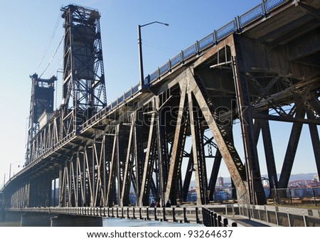 Sharp image of bridge railing post with very soft image of Portland in background - stock photo