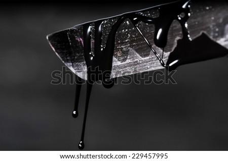 Sharp Katana Sword Blade Dripping Black Color Painting - stock photo