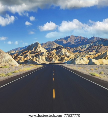 Sharp on the road, crossing Death Valley in California. A trip to the high speed - stock photo