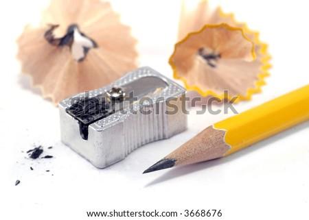 sharp pencil, sharpener and shavings - stock photo