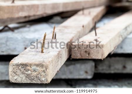 sharp rusty nail stick on wood - stock photo